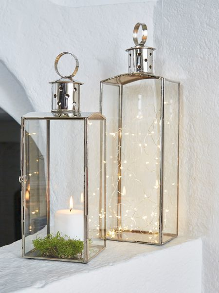 Less is most definitely more when it comes to these refined silver nickel and glass candle lanterns.