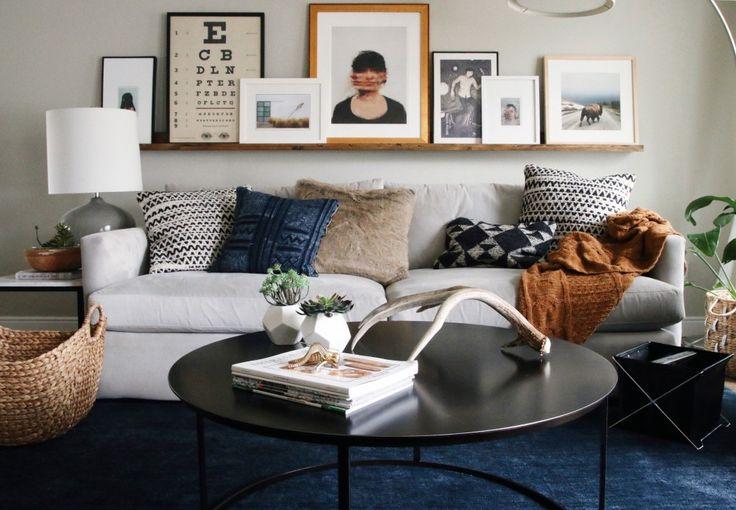 Art arrangement over sofa.  Our Current Home | Chris Loves Julia