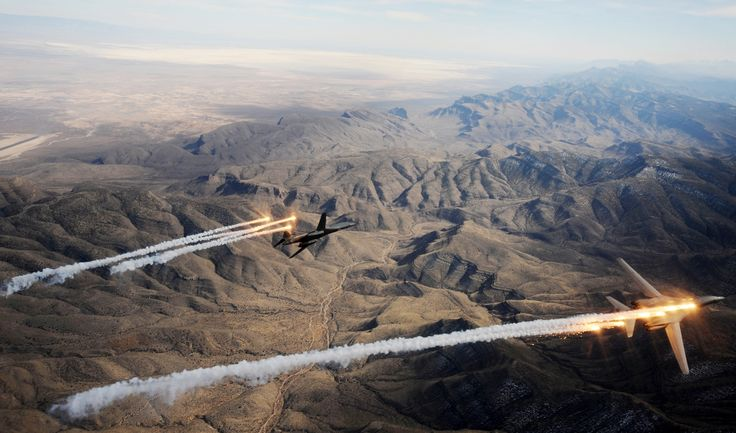 A two-ship of B-1B Lancers assigned to the 28th Bomb Squadron, Dyess Air Force Base, Texas, release chaff and flares while maneuvering over New Mexico during a training mission Feb. 24, 2010. Dyess celebrates the 25th anniversary of the first B-1B bomber arriving at the base.
