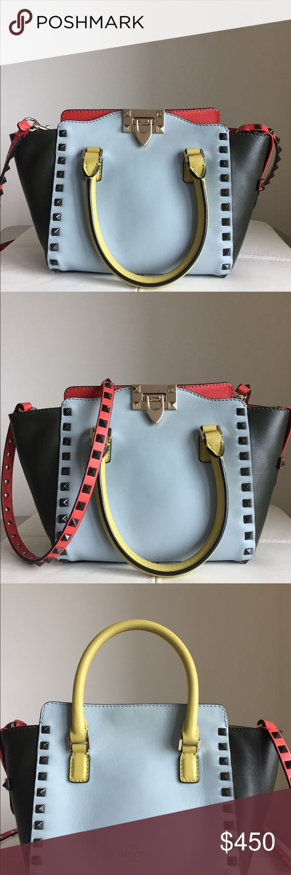 Valentino Rockstud Satchel/ Crossbody Authentic Valentino Rockstud handbag that can be worn as a Satchel or crossbody. Fun color combination of grey, coral, black and yellow with noir (black) studs and silver hardware. Was purchased at a sample sale hence the black mark on the label. In good condition and comes with a Valentino duster bag. Valentino Bags Satchels