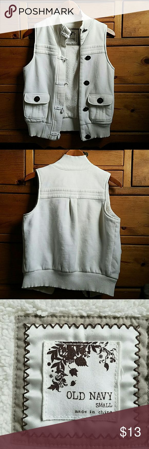 Old Navy Cream Vest Cream colored Old Navy vest with brown buttons and toggle closures over a zipper. Very cozy, with fuzzy fleece lining. Old Navy Jackets & Coats Vests