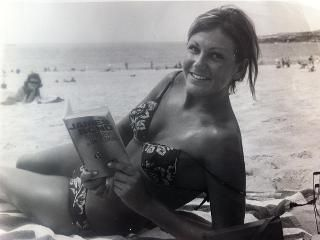 Pat Mayne reads the adventures of her hero while relaxing in the sun on Coogee Beach, 1966 Picture: Supplied by Sarah Mayne