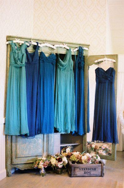 Aqua and blue bridesmaids' dresses via Amsale