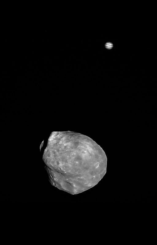 Phobos in the foreground with gigantic (but very distant) Jupiter sitting in the background, a fortuitous alignment that the Mars Express High-Resolution Stereo Camera team took advantage of on June 1.