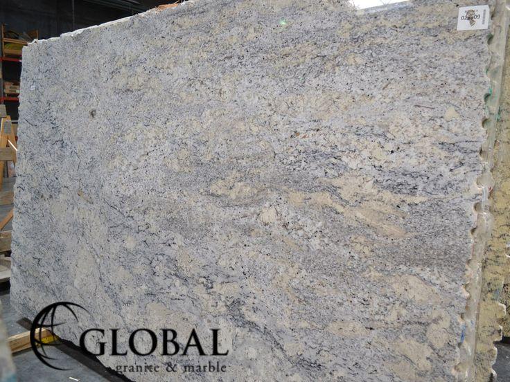 New White Spring polished granite slab. Visit globalgranite.com for your natural stone needs.