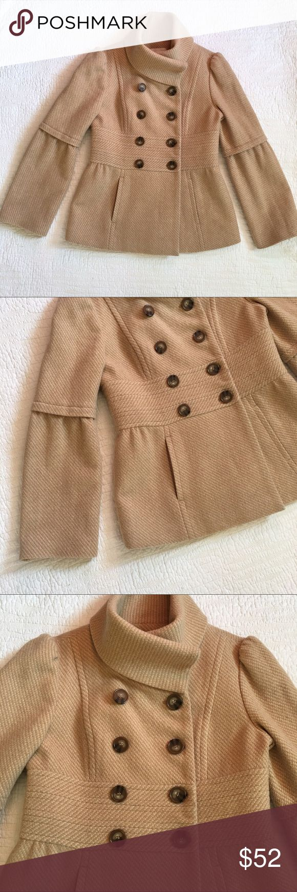 """Loft Wool Bell-Sleeve Funnel-Neck Pea Coat Gorgeous tan wool blend coat from Loft. This waist length coat features a peplum skirted waist, funnel-neck detail, and bell sleeves. Big tortoise shell buttons add detail, as does a thick waist band. This coat is gorgeous. Coral piping along lining is another sweet detail. In excellent condition with no noticeable flaws except a very tiny hole on the collar - not noticeable unless you look. See last photo. Size 4. Appx 36"""" bust, 26"""" length, 33""""…"""