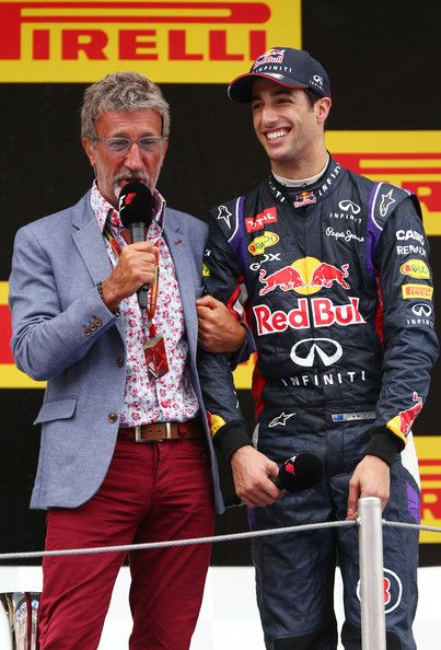 Daniel Ricciardo of Australia and Infiniti Red Bull Racing speaks with Eddie Jordan on the podium after the Spanish Formula One Grand Prix a...