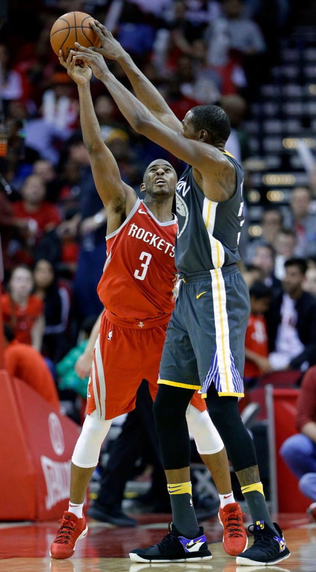 3e1d99bc7 Houston Rockets guard Chris Paul (3) tips a shot-attempt by Golden State  Warriors forward Kevin Durant (35) during the second half of an NBA  basketball game ...