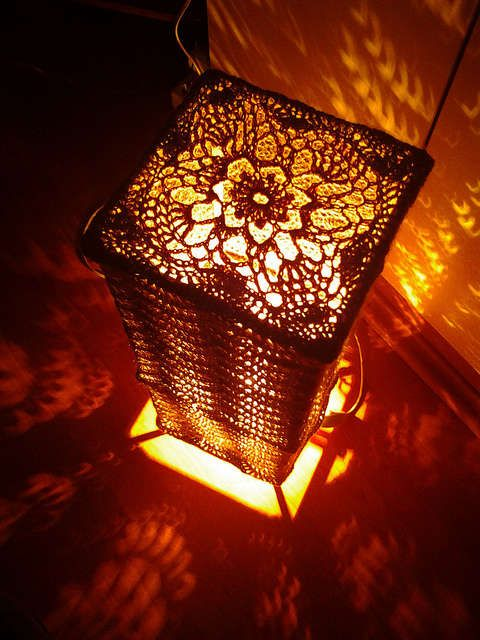 There is a free crochet pattern for this beautifully designed lamp offered via Ravelry.