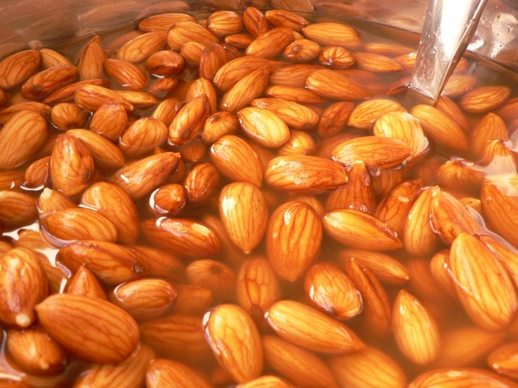 How to eat almonds: Soak raw almonds. 2 cups of water per 1/2 cup of almonds. Add salt (to help neutralize the enzymes). Soak almonds 7-8 hours, then drain... and dry in oven (no higher than 150°F).