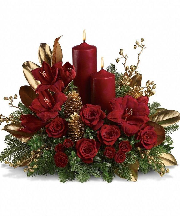 decorazioni floreali: un'idea perfetta per il Natale con candele e fiori rossi