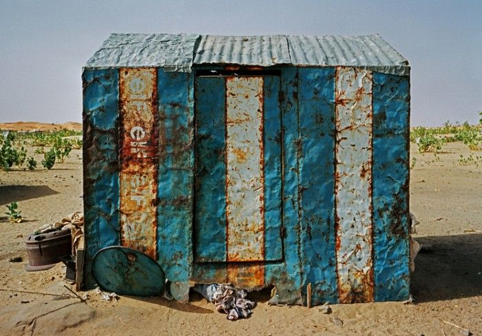Huts of Mauritania. Girls are force fed here, where obesity is considered sexy.