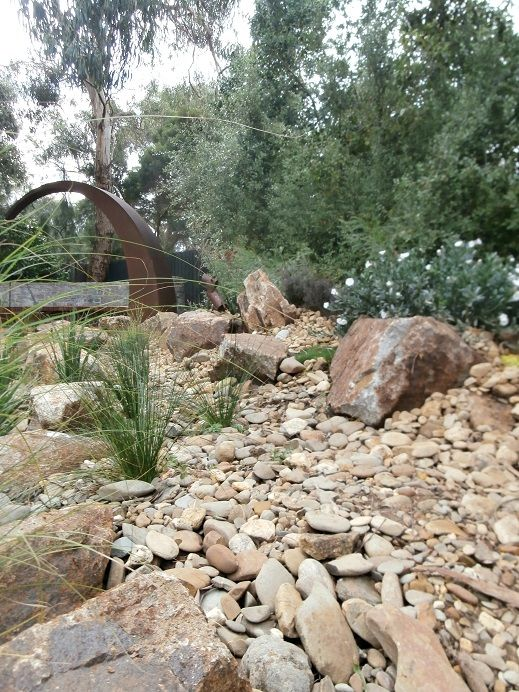 Dry Creek bed leading to fire pit area designed and constructed by the team at Abben Art Garden Design