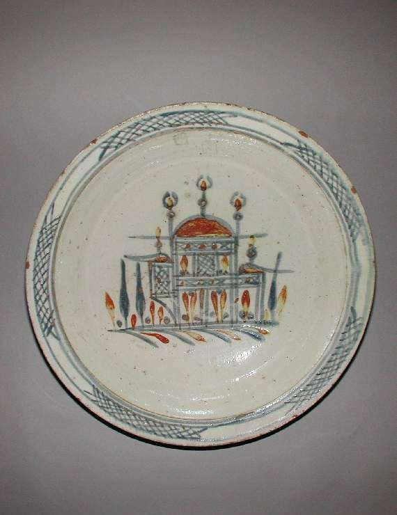 Fitzwilliam Museum Collections Explorer - Object C.1987-1928 (Id:72933)...dish Islamic pottery; category Çanakkale ware; c. 1800 — 1900 painted in blue, brown and yellow in or under a white glaze. The centre is painted with a Turkish pavilion and cypress trees conventionally treated. The narrow rim has a Chinese trellis border interrupted by blank panels. height, whole, 7.7, cm width, whole, 32.2, cm diameter, rim, 32.2, cm diameter, base, 8.9, cm weight, whole, 1266, g