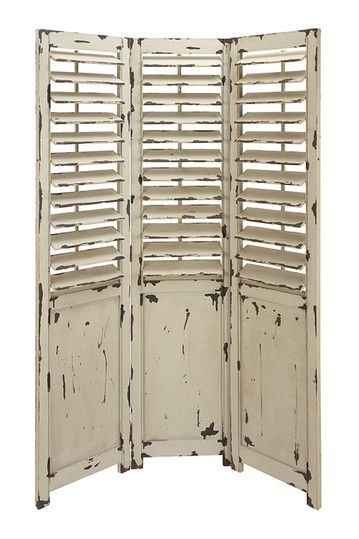 Farmhouse finish shutter door Room screen.  Cool.. I have a special love for chippy shutters!! :)