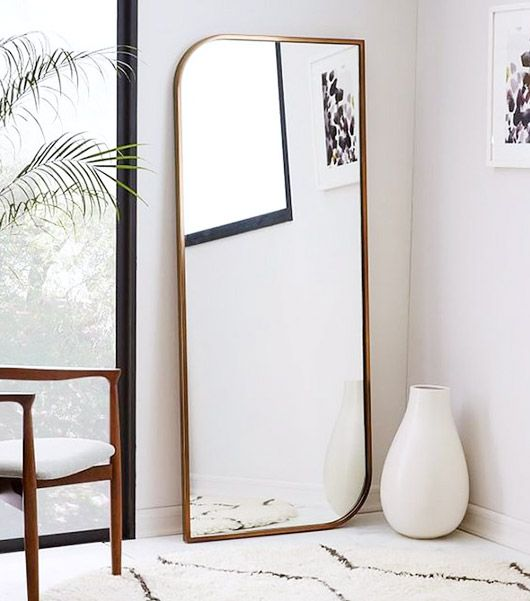 unique curved mirror with brass frame. / sfgirlbybay