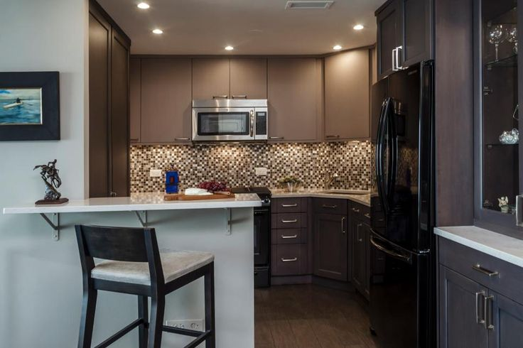under cabinet appliances kitchen this small kitchen with wood cabinets and black 6500