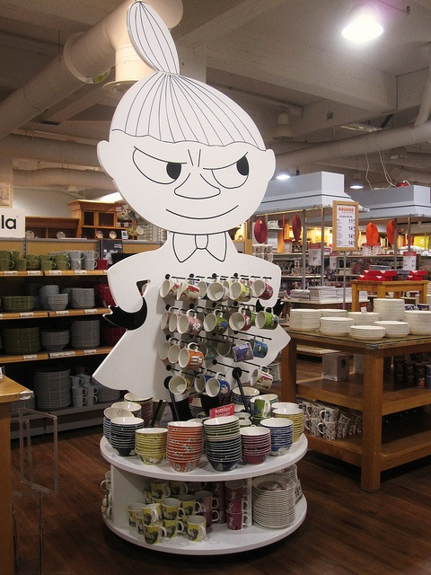 Looks like Little My is daring you to buy one! (Little My selling moomin mugs by Hannhell via Flickr)