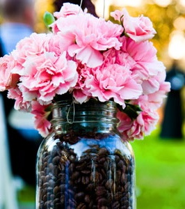 Coffee beans as a jar filler for flowers arrangements. Love this idea!