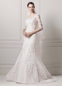 You will look flawless in this romantic lace trumpet gown! Lace trumpet gown with 3/4 sleeves has an ultra-feminine illusion neckline and features layered beaded lace appliques. Chapel train. Sizes 0-14. Available in Ivory. White available by special order in store only. Petite: 7CWG638. Sizes 0P-14P. $1,350. Special order only. Woman: 8CWG638. Sizes 16W-26W. $1,450. Select stores and special order. To preserve your wedding dreams, try our Wedding Gown Preservation Kit.Train that extends one…