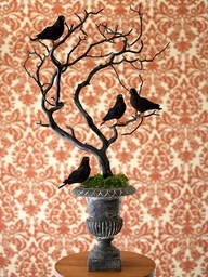 OKAY, okay! I know this is Halloween decor, but with some winter birds from Michaels instead of crows, the branch either spray painted white or silver, or left brown with faux red berries; and the base spray painted the color of your choice; this same basic idea would be SO perfect for Christmas!