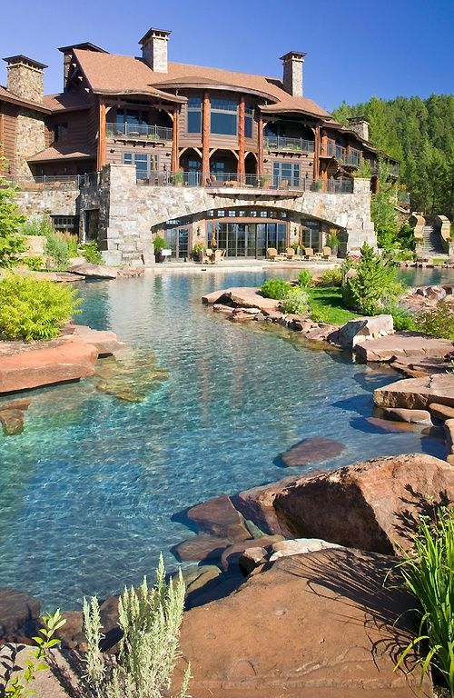 Lodge with lazy river in backyard. Add Treehouse.