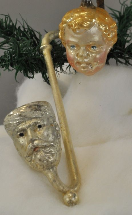 Meerschaum pipe with man's head and baby Jesus' head. Blown glass German Christmas ornaments.