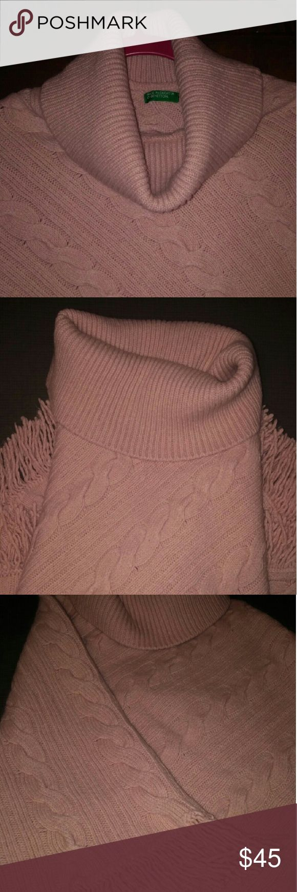 "BENETTON Turtleneck Cable Poncho with Fringe Light pink / blush rose color. 50% Wool 50% Acrylic. About 29"" long not including neck and fringe, 34"" wide not including fringe and 7.5"" unfolded neck. Fringe is about 3"". Dry clean only. Bundle for discount and to save on shipping. Happy Shopping!! United Colors Of Benetton Sweaters Shrugs & Ponchos"