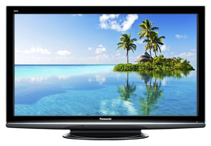 Mi familia y yo relajamos a casa y miramoa programas de televisión.