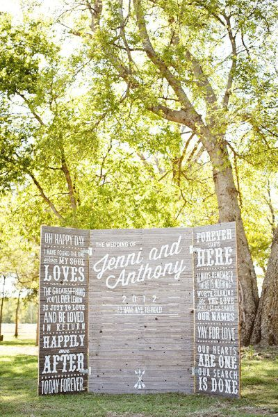 A custom built wooden panel folding screen with painted white lettering can double as a ceremony program and ceremony backdrop...could be made into a rental piece by doing the names in white vinyl lettering (or even make all of the quotes changable!)