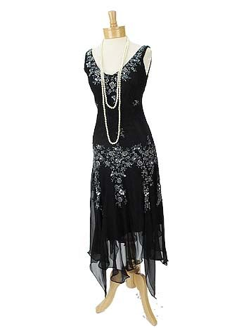 Floaty black silk chiffon flapper style dress reminiscent of Gatsby Era fashions with an updated modern silhouette. A stunning look for evening, especially for Roaring 20's vintage themed events. Add a cloche hat or feather headband, T strap Mary Jane pumps, long strands of pearls, and a fringed wrap to complete a sensational 20s inspired look.