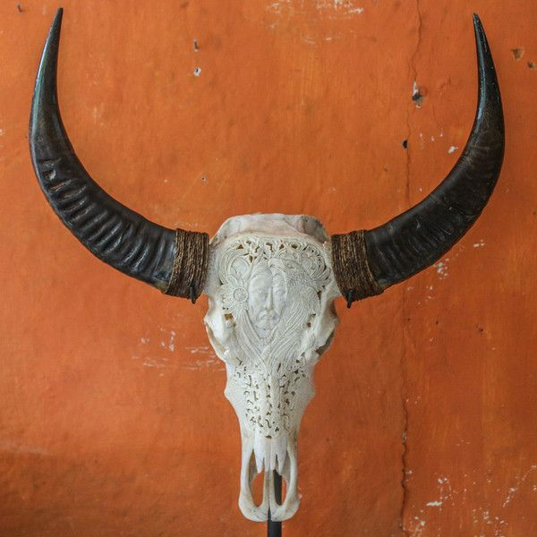 Buffalo Skull - Indian & Eagle Carving  Each long horn skull is unique due to the fact that each craftsman puts his individual touch to the carving process.