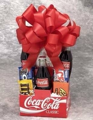 Gift basket for the movie lover using a coke box. Add some movie tickets to complete this awesome gift
