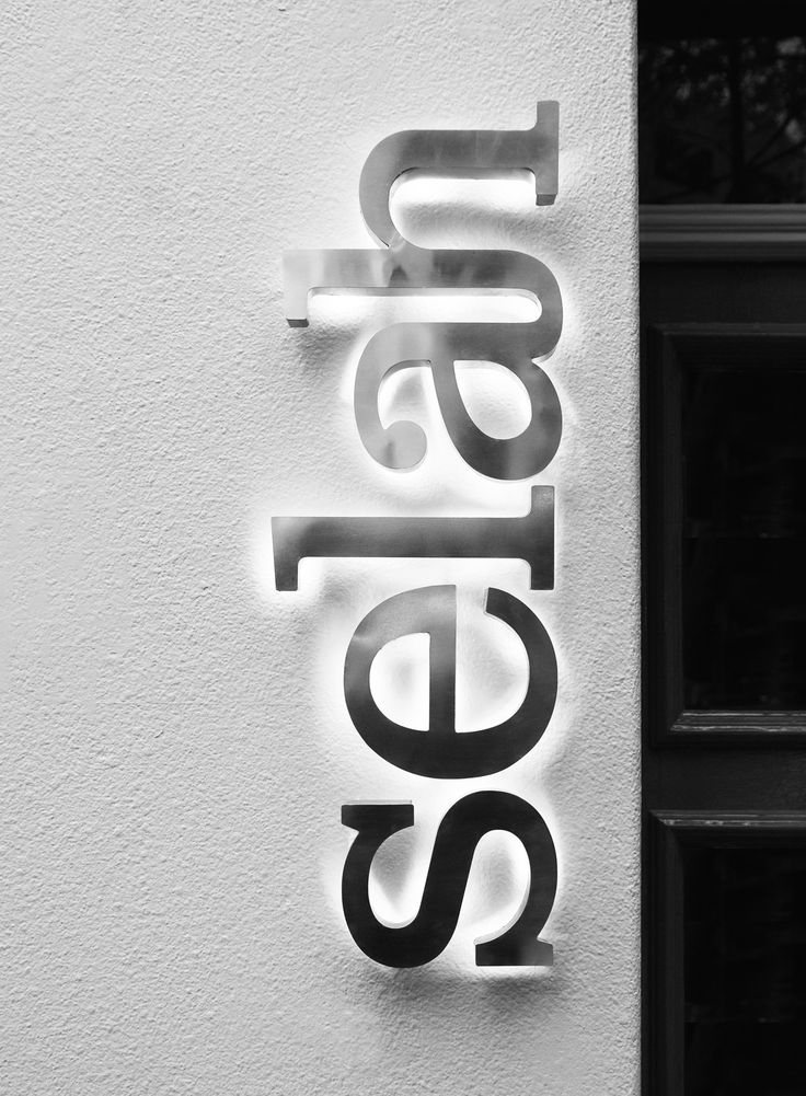 Selah Restaurant | Brand Identity on Behance - Back lit dimensional text / halo lighting
