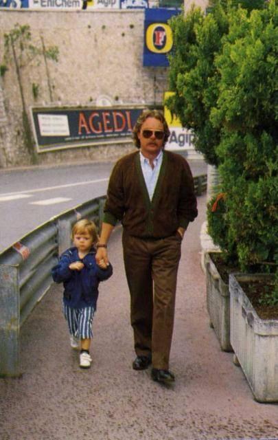 A great shot of Keke Rosberg, with son Nico, walking around Monaco.