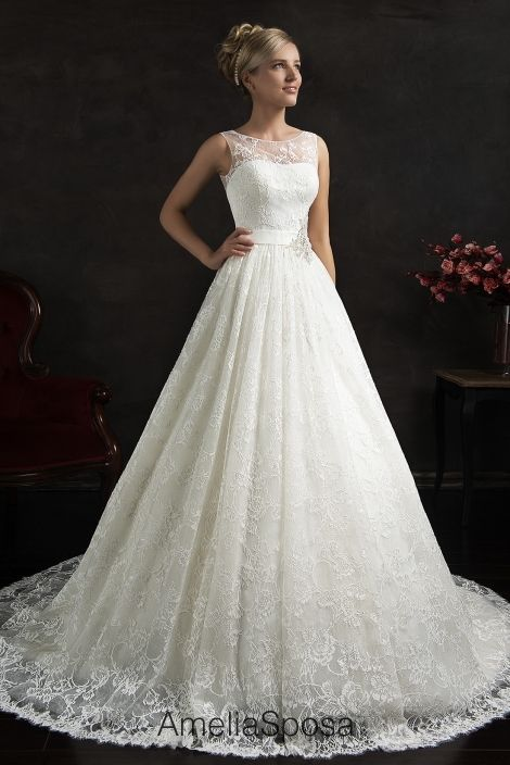 2015 Maritza wedding dress from Amelia Sposa. Front view. White. Floor length. Sleeveless. Floral overlay. Belted waist.