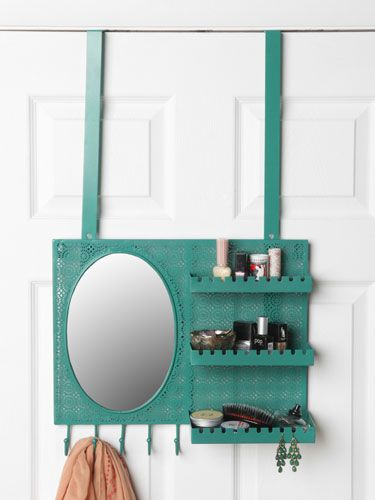 This mirror hangs over your door and has space to store your makeup—so convenient!