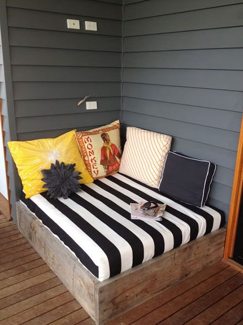 Reading Nooks: A porch corner has been transformed into a comfortable spot to read a book.