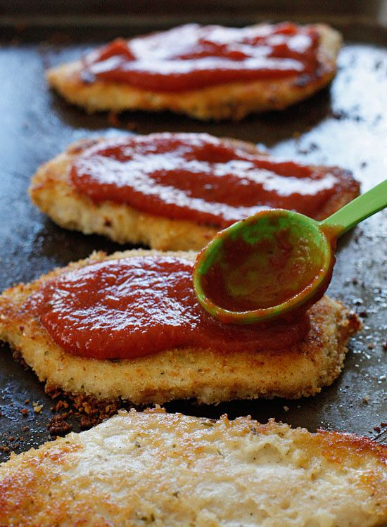Baked Chicken Parmesan   Try with pizza sauce and sliced moz cheese. Skip butter. Spray.