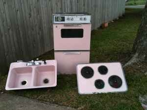 Vintage pink appliances!  I once went apartment hunting with my aunt and this one complex had vintage appliances, but each unit had a different color.  So cool.