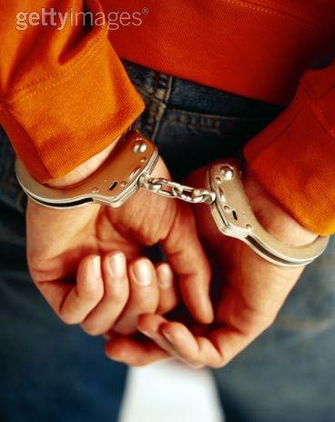 Man's handcuffed wrists