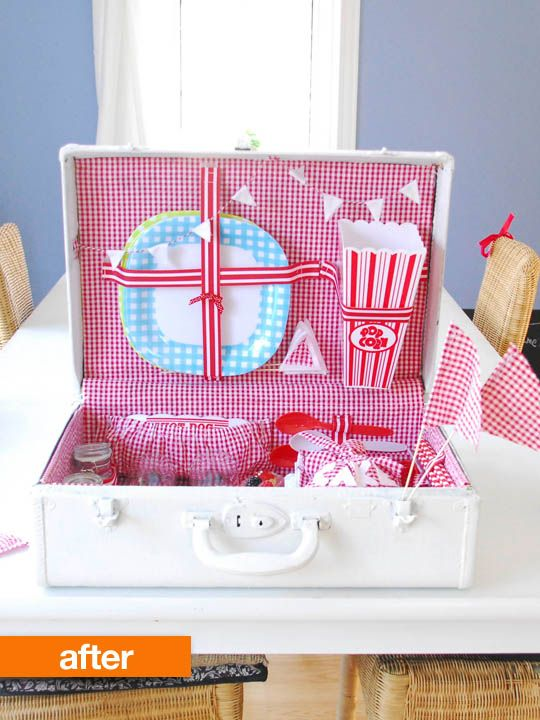 vintage suitcase turned ADORABLE picnic case.  SO DOING THIS NEXT WEEK. I don't think I'd mess with the outside of it.