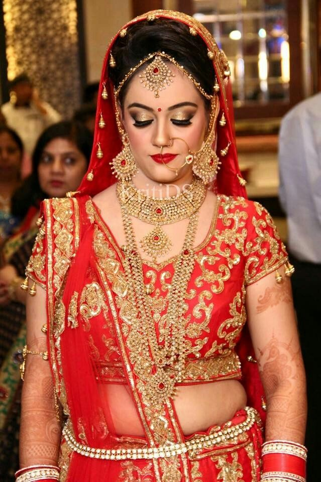 Love the bridal makeup! Not so much the lengha.