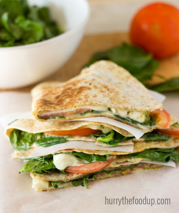 Spinach Tomato Quesadillas. Easy to make and ready in fifteen minutes max. Really tasty! It's packed full of vitamins K and A, B2 and B6, C, calcium and potassium. | hurrythefoodup.com