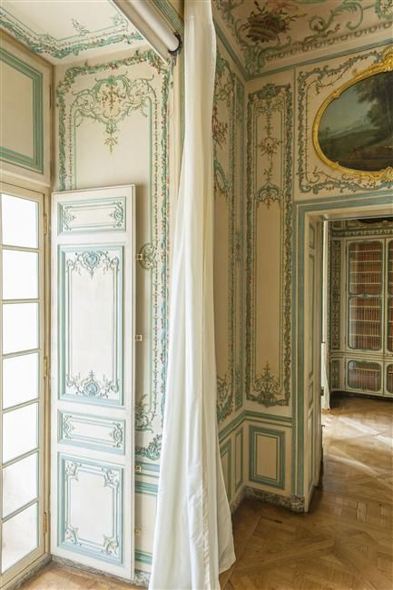 Interior cabinet of the Dauphine in Versailles, with elegant pannel room and french parquetry.
