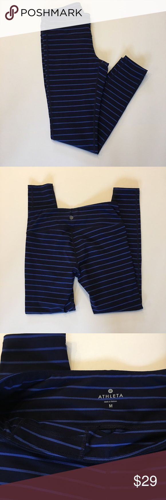 Athleta Chaturanga Navy Tights, Size Medium Athleta Chaturanga Navy Tights, Size Medium. Navy full length tight with lighter blue stripes. Pants are in great condition. Medium rise with interior waist pocket.  Washed and ready to wear. Home is smoke free. Athleta Pants