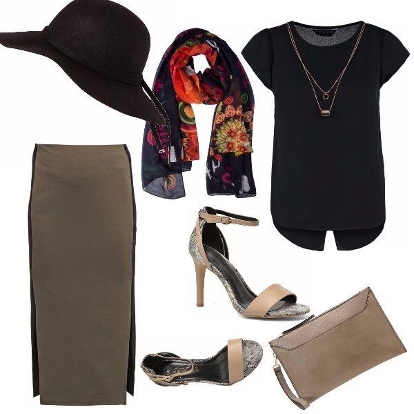 Un outfit di classe per una grande città: il foulard dona un tocco di colore sempre sul tema dell'autunno, il cappello è sempre di classe ma bisogna saperlo portare.