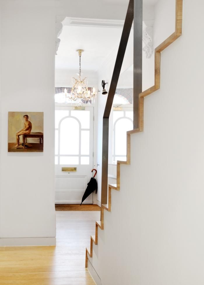 Modern and Victorian details together in London entryway remodel