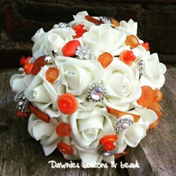 Ivory rose and orange bouquet! www.dawniesweddingbouquets.co.uk.🌸