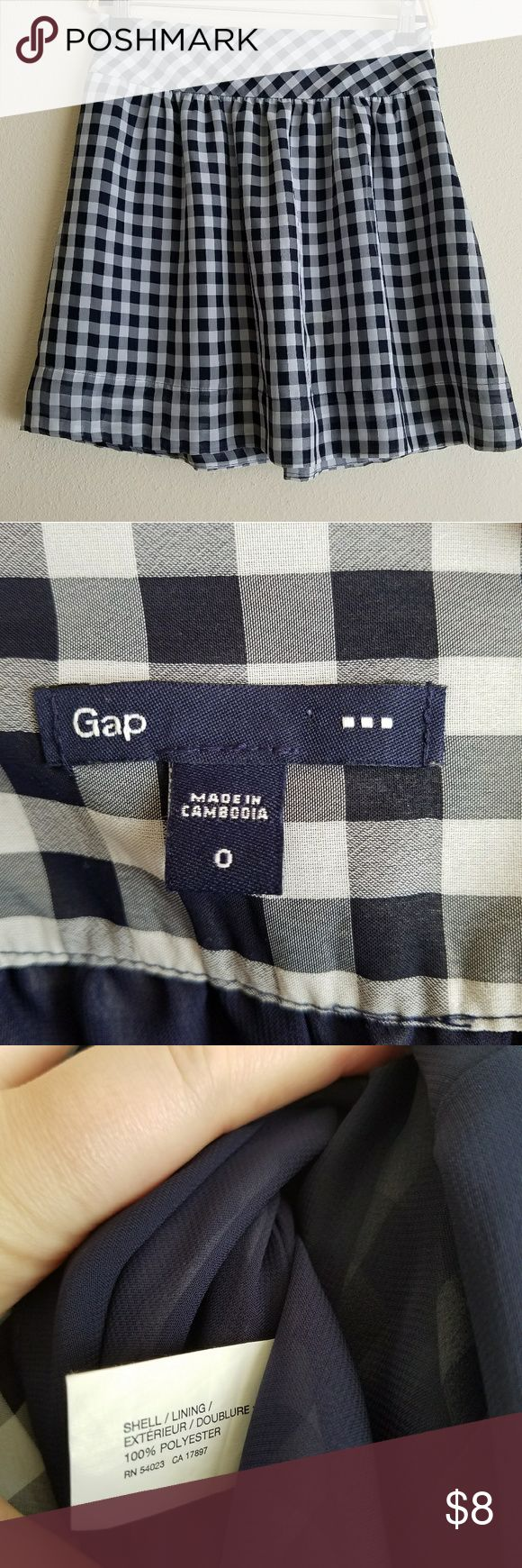 Sz 0 Mini Skirt Checkered Plaid Gap Brand: Gap Size: 0 Color: Navy blue, white Notes: Hidden side zipper lightweight swing mini skirt, checker board plaid pattern Condition: In very good used condition GAP Skirts Mini